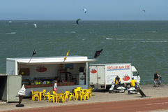 Snack bar, tourists and surfers on the North Sea Royalty Free Stock Images