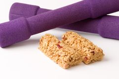 Snack bars and dumbbells. For active people Stock Photo