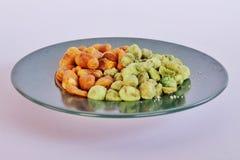 Snack Bean. Broad Bean, Green, nut, salt, wasabi Stock Photo