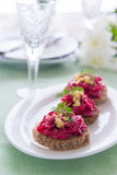 Snack from beetroot pesto and walnuts Stock Photo