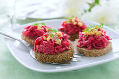 Snack from beetroot and walnuts Stock Photography