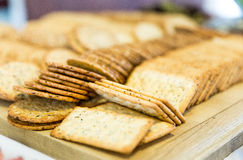 Snack Biscuit. Afternoon snack arranged on a chop board in the kitchen Stock Photos