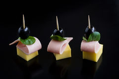 Snack on black background. Three delicious appetizers on black background Royalty Free Stock Image