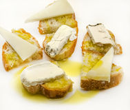 Snack of bread and goat cheese Stock Image
