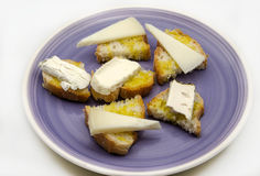 Snack of bread and goat cheese Royalty Free Stock Image