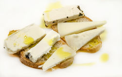 Snack of bread and goat cheese Stock Images
