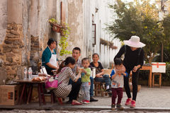 Snack break. DIPU VILLAGE, ZHEJIANG PROVINCE, CHINA - OCTOBER 25: Chinese tourists enjoy a snack break in Dipu on Oct. 25, 2014. Dipu is a national historical Royalty Free Stock Photos