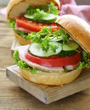 Snack burger with fresh vegetables and ham Stock Photos