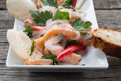Snack ceviche with salmon, onions and chili. Snack ceviche with salmon, onions chili and krupuk Stock Photos
