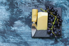 Snack cheese with fruit. On a black board Stock Images