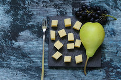 Snack cheese with fruit. On a black board Royalty Free Stock Photography