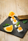 Snack cheese with quince and fresh oranges Royalty Free Stock Images