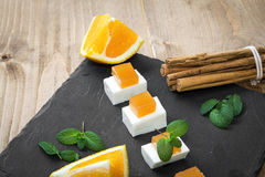 Snack cheese with quince and fresh oranges Stock Image
