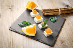 Snack cheese with quince and fresh oranges Royalty Free Stock Photo