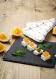 Snack cheese with quince and fresh oranges Stock Photos