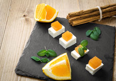 Snack cheese with quince and fresh oranges Royalty Free Stock Image