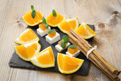 Snack cheese with quince and fresh oranges Stock Photo