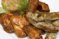 Snack - chicken wings, sausages, pork ribs Royalty Free Stock Image