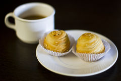 Snack and coffee. On brown wood with shallow focus Royalty Free Stock Photography