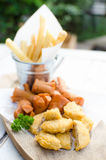 Snack combo. Serve with french fries sausage and fried nuggets stock images