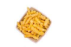 Snack corn cheese in square bowl from above Stock Image