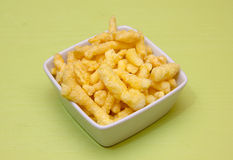 Snack corn cheese into square bowl of green Stock Photo
