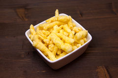 Snack corn cheese in square bowl on wood Royalty Free Stock Images