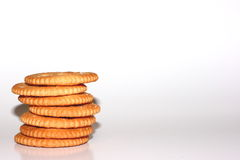 Snack Crackers. A stack of salty snack crackers on a light background Royalty Free Stock Image