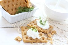 Snack crackers with cream cheese and dill Royalty Free Stock Images