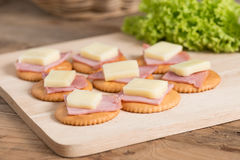 A snack of Crackers with ham, cheese. Royalty Free Stock Image