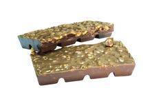 Snack; de amandelschors van de onduidelijk beeld Donkere chocolade in een stapel Royalty-vrije Stock Afbeeldingen