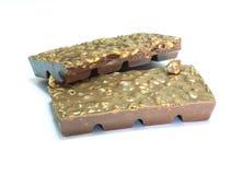Snack; de amandelschors van de onduidelijk beeld Donkere chocolade in een stapel Stock Afbeeldingen
