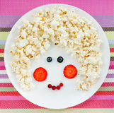 Snack or dessert for baby girl - sweet popcorn with strawberry a Stock Photos