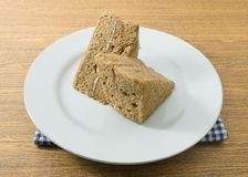 Dish of Two Delicious Triangle Coffee Chiffon Cake royalty free stock photos