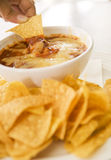 Snack (Dipping action) Royalty Free Stock Photography