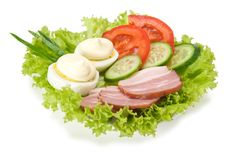 Snack from the egg, mayonnaise, smoked bacon and v Royalty Free Stock Photos