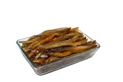 Snack fish catfish in a square transparent plate.