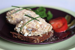 Snack: fish paste on rye bread. With cereals royalty free stock photos