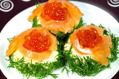 Snack with fish and red salmon caviar Royalty Free Stock Image