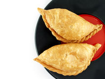 Empanada - Argentine fried meat pies on plate isolated on white background Stock Photos