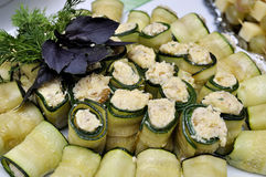 Snack with food rolled in cucumber. Served with dill and basil Royalty Free Stock Photos
