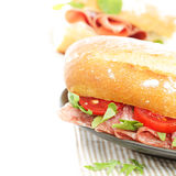 Snack food sandwich with salami Stock Image