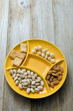 Snack Foods. Mixed dried fruit and nuts in a yellow serving bowl Stock Image