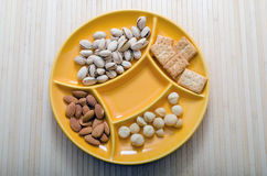 Snack Foods. Mixed dried fruit and nuts in a yellow serving bowl Stock Photography