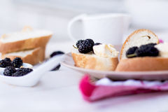 Snack on french baguette on a wooden board. Mulberry Royalty Free Stock Photo
