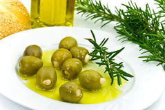 Snack with fresh olives,oil and sesame bun Stock Photography