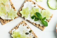 Free Snack From Wholegrain Rye Crispbread Crackers And Cucumber Royalty Free Stock Image - 94941686