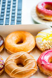 Snack from Glazed Doughnuts near Laptop on Working Desk Stock Image