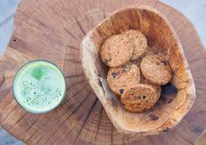Snack. Halthy snack with brokoli juice and oautmil biscuits served in hand made wooden bowl royalty free stock photos