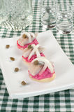 Snack from a herring. Potato tartlets with a herring and mousse from a beet Stock Photography